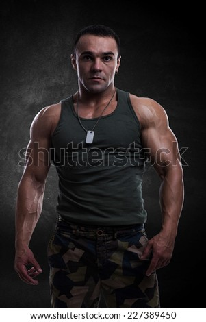 Athletic man in military clothing - stock photo
