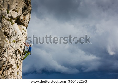 Athletic man rock climbing on the wall