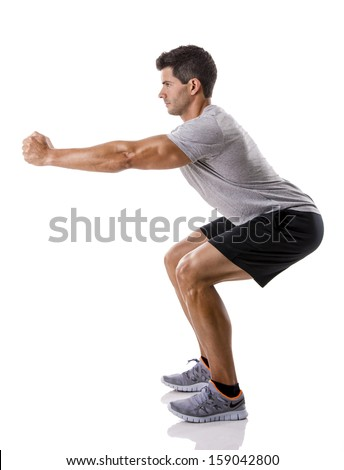 Athletic man running doing squats, isolated over a white background - stock photo