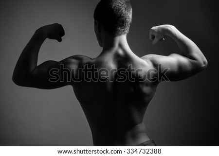 Athletic man. Seen from behind. Black and white