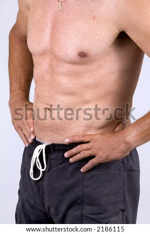athletic man standing up holding his hands in the waist