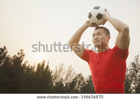 Athletic Man Throwing Soccer Ball