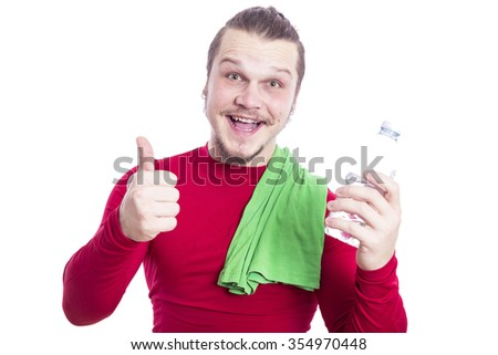 athletic man with a bottle of water and towel