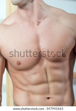Athletic man with six-pack abs.