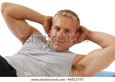 Athletic muscular man doing situps - stock photo