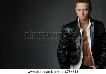 athletic, muscular man in a model shooting - stock photo