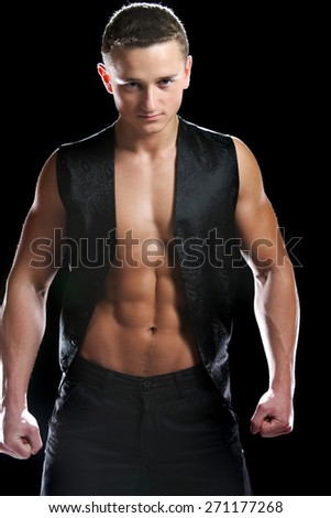 athletic, muscular man in a model shooting . strength and beauty - stock photo