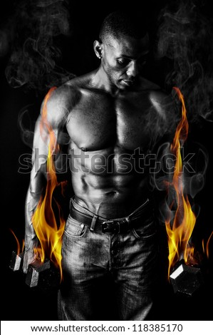 Athletic Muscular young man with Weights on Fire for Motivation - stock photo
