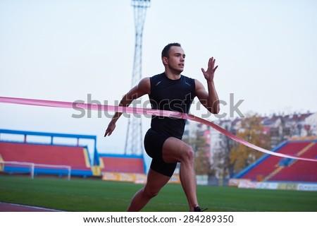 athletic runner finish line track - stock photo