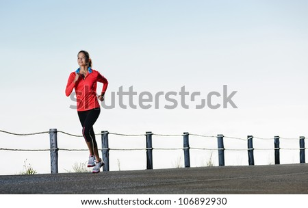 Athletic runner training alone on a road outdoors for marathon and fitness. healthy wellness exercise panorama with copyspace. - stock photo