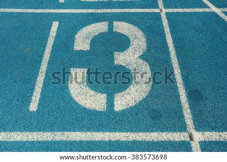 Athletic running track with number three - stock photo