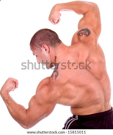 Athletic sexy attractive male body builder, demonstrating contest pose. Studio shot, black white ground. - stock photo