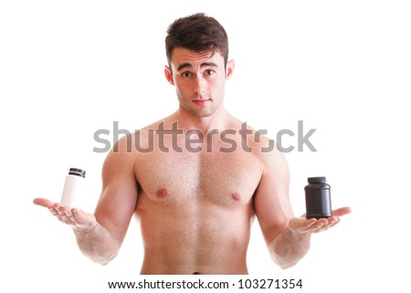 Athletic sexy male body builder holding a boxes with supplements on his biceps, man holding bottle of pills - stock photo