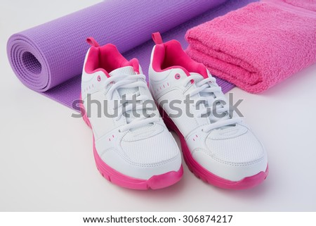 Athletic shoes and mat after workout sweat