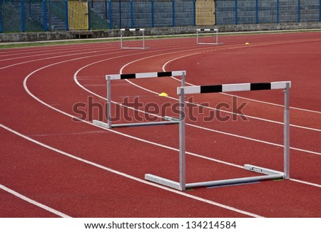 athletic stadium and some hurdles in athletic lines - stock photo