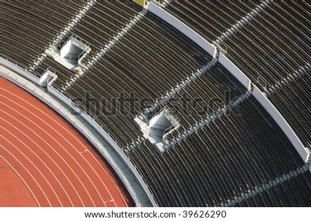 athletic stadium with empty seats viewed from above - stock photo