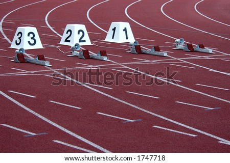 Athletic stadium with running-tracks and start blocks - stock photo