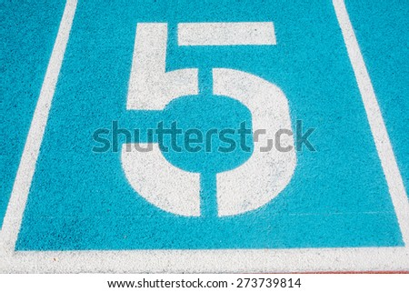Athletic Surface Markings -- Number five -- in bright colors, using - stock photo