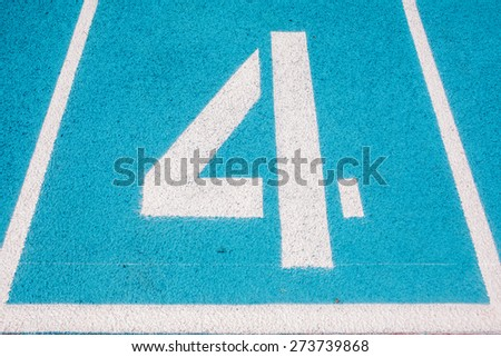 Athletic Surface Markings -- Number four -- in bright colors, using - stock photo