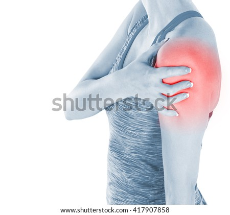 Athletic woman in sports wear pressing her hand against a painful shoulder