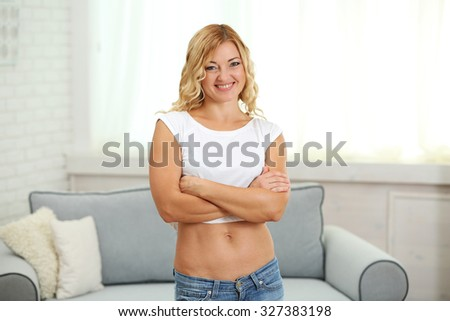 Athletic woman on home interior background