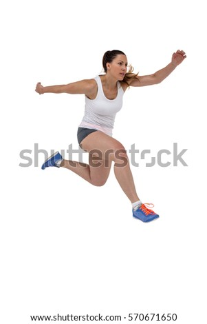 Athletic woman running on isolated white background