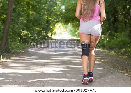 Athletic woman running outdoors