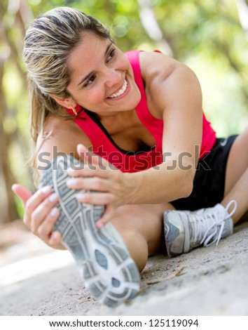 Athletic woman stretching after a good workout session - stock photo