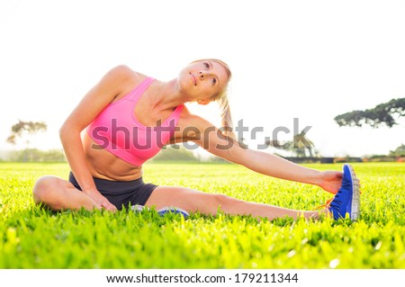 Athletic woman stretching before workout - stock photo