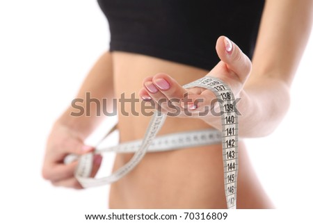 Athletic woman with measure tape - stock photo