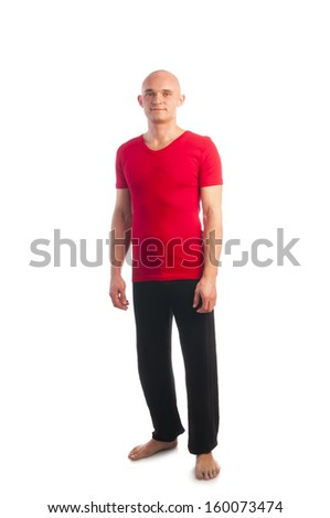 Athletic young bald man in red t-shirt isolated on white background, full length shot - stock photo