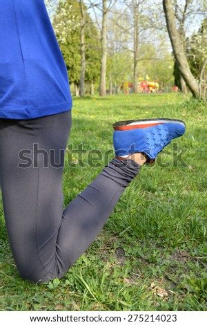 athletic, young,  girl doing exercises on the nature