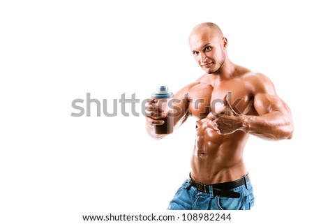 athletic young handsome man with shake bottle. Isolated on white