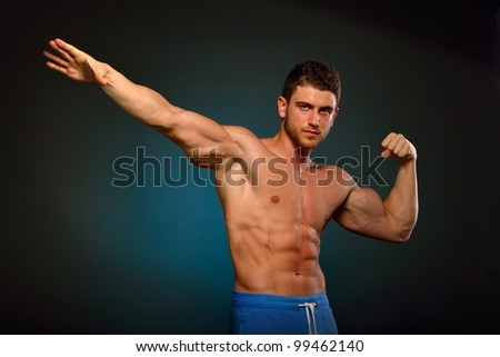 athletic young man - stock photo