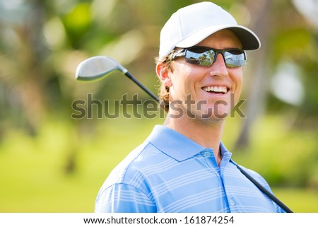 Athletic young man playing golf, Portrait of Golfer on Course with driver - stock photo