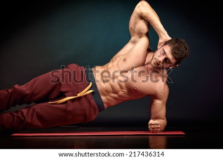 athletic young man portrait in studio - stock photo