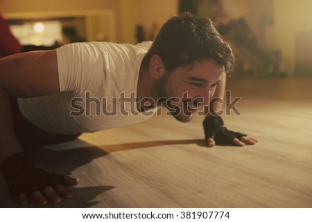 Athletic young man working in gym - stock photo