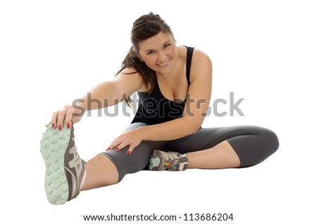 athletic young woman doing gymnastics / sporty woman - stock photo