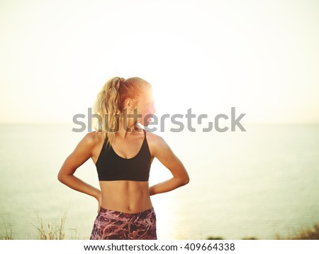 Athletic young woman exercising outdoors