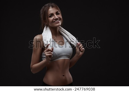 Athletic young woman isolated over dark background - stock photo