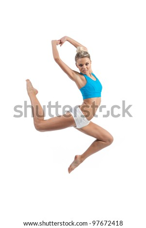 athletic young woman on a white background in the jump