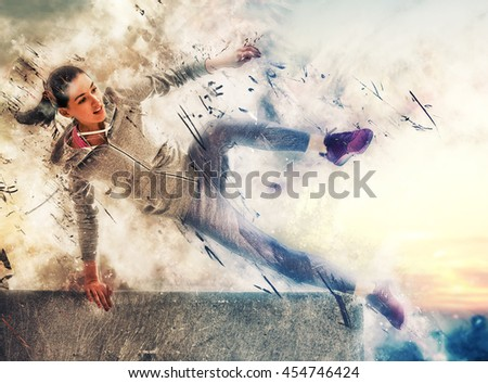 Athletic young woman running in the nature. Healthy lifestyle.  - stock photo