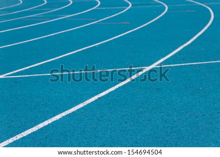 Athletics running track on the curve - stock photo