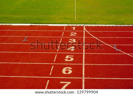 Athletics track in stadium - stock photo