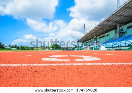 Athletics track in stadium on sunny day - stock photo