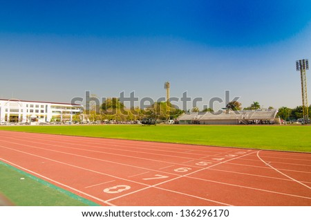 Athletics Track Lane Numberswith blue sky - stock photo