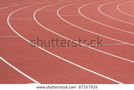 Athletics track with its lane, white lines and turn