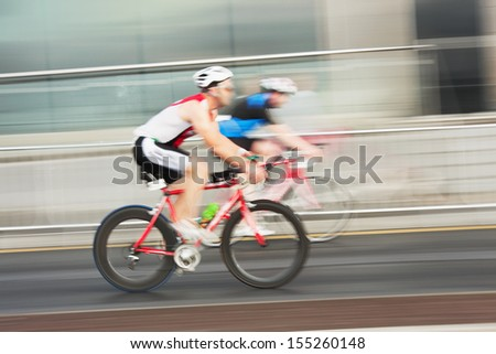Athlets on the bicycles competing in the race, blurred motion - stock photo