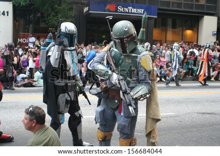 ATLANTA - AUGUST 31: Jango and Boba Fett pause to pose in the middle of the annual DragonCon parade held over labor day weekend on August 31, 2013 in Atlanta, GA.