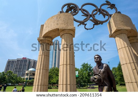 ATLANTA - August 5: Pierre de Coubertin commemorative statue at Centennial Olympic Park August 5, 2014 in Atlanta, GA. Coubertin is considered founder of the modern Olympic games. - stock photo